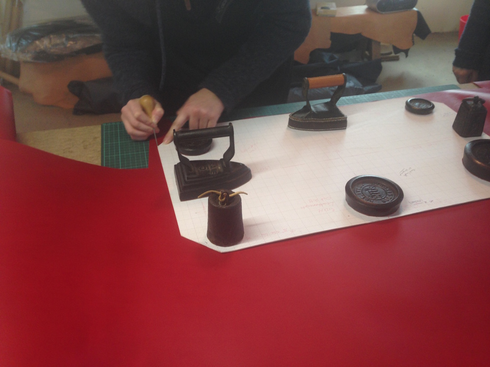 Cutting out the leather by hand