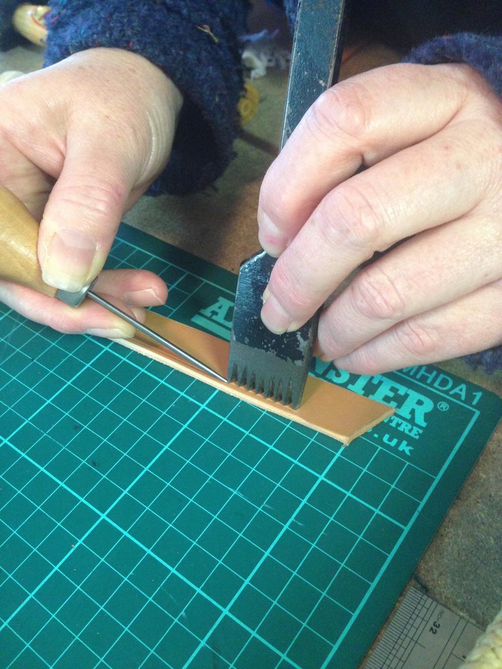 2. Preparing to hand stitch the leather.jpg