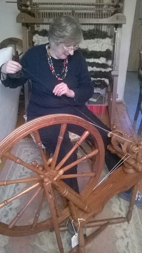 Students learning at the spinning wheel